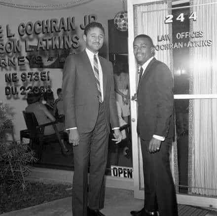 Johnnie Cochran posing outside the Law Offices of Cochran & Atkins